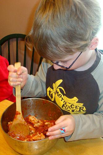Bubble Up Pizza Recipe - E Stirs the Mixture