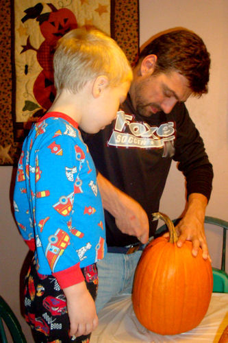 Carving Pumpkins 2010 - Teacher and Little Guy