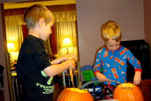 Carving Pumpkins 2010 - Z-Man and Little Guy Scooping Goop