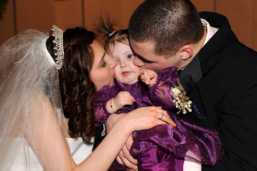 Flower Girl Peanut Gets a Squisy-Face Kiss