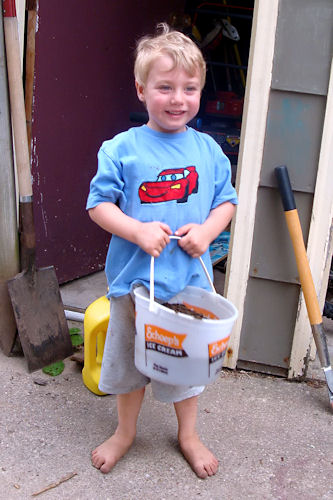 Raised Garden - And Carries his Bucket