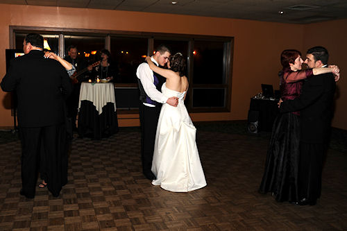 Wedding Reception - Newlyweds and Parents Dancing