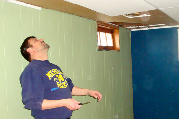 Egress Window - Teacher taking Down Ceiling Tiles