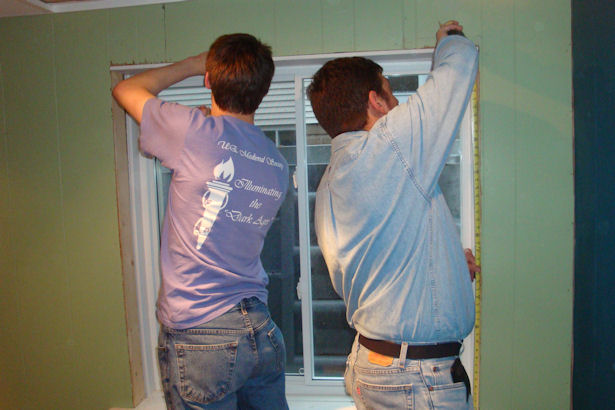 Egress Window - Father and Son Working