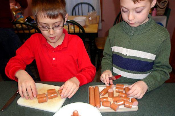 Mini Corndog Muffins - Boys Cutting Hot Dogs